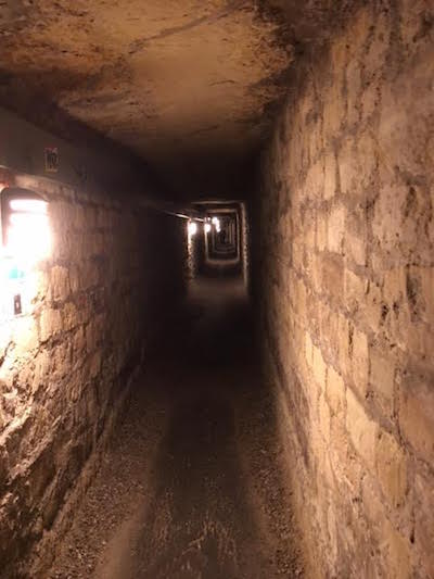 the catacombs, the catacombs of paris,paris, tourist, travel, paris travel, paris gays, france, haunted places, husband and husband, jonathan l. ferrara, aaron ferrara, gay bloggers, scary places, dark figures, ghost, apparition, shadow people